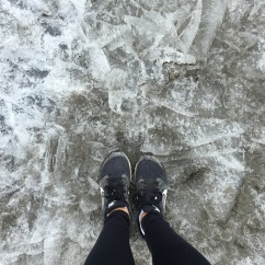 ice ice baby. standing on a frozen section of the lake